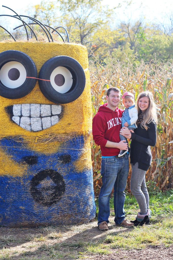 Hay bale minions at a pumpkin patch family outing