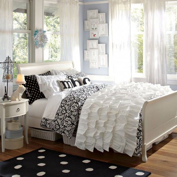 Love the ruffle bed cover and the soft white curtains. Nice idea for black and white scheme with shades of light blue on walls.