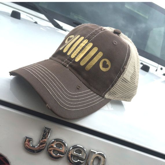 Jeep Girl Trucker Hat: Adjustable Back, Destroyed Style brown baseball cap with distressed coloring and gold jeep grill design.   - 100% cotton, chino twill front  - 100% polyester, soft mesh back  - Structured, mid-profile, six-panel  - Pre-curved contrast stitch visor  - Contrast fabric stripes on side panels  - Plastic tab closure  See our collection of Jeep Girl Shirts: Jeep Girl: https://www.etsy.com/listing/285904107/jeep-girl-shirt-womens-oversized-v-neck?ref=shop_home_active_5  Titty…
