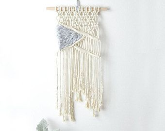 DIY Macrame Wall Hanging! Macrame Wall Hanging Kit with Macrame Knot Guide & Complete Wall Hanging Pattern designed in Chicago. This macrame wall hanging kit is super easy to follow, perfect for beginners and makes for a fun afternoon or evening. KIT INCLUDES: - 100% High Quality Cotton Rope Conveniently Precut to 10 sections so you can instantly get started on your piece - Handmade Hanging Loop so your piece can display in your home with ease - 12 Wood Dowel - 2, S Hooks to help set up ...