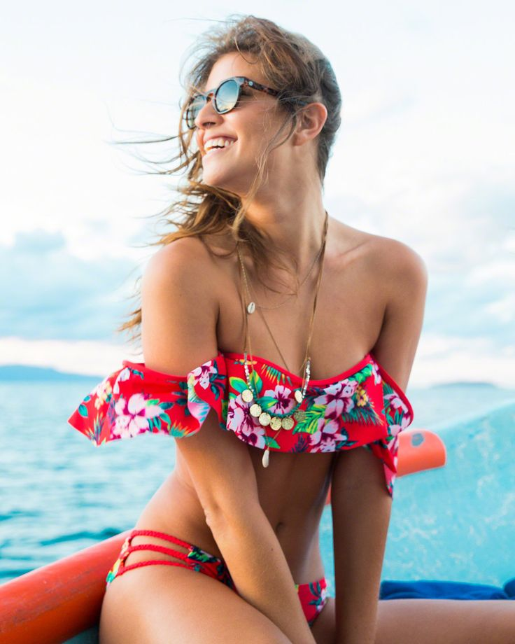 A super-flattering off-the-shoulder bandeau swim style, featuring removable pads, and drapey all-over flutter, Imported