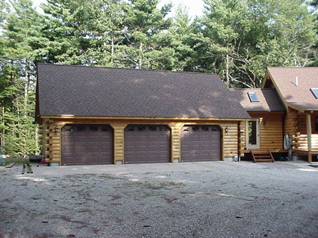 17 best log garages images on pinterest carriage doors for Log home garages