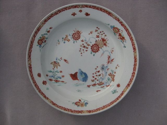 """Bow plate painted  in the Kakiemon manner with  the  """" Two Quail """" Pattern. Brick red and gilt border  Unmarked  Circa  1760 Width 9"""""""
