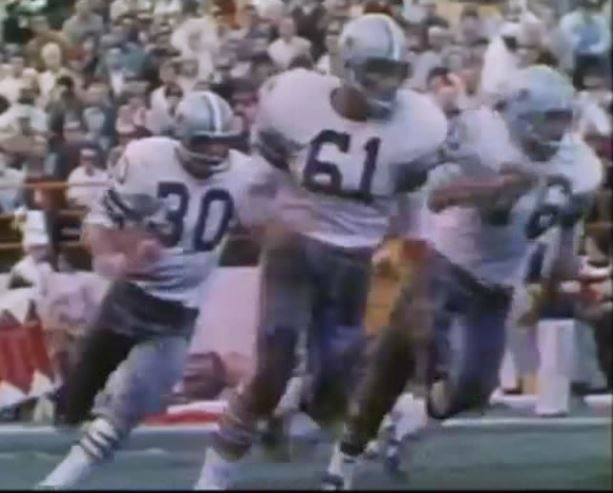 Running back DAN REEVES (30) runs for daylight as guard JOHN NILAND (76) holds down the fort--1970