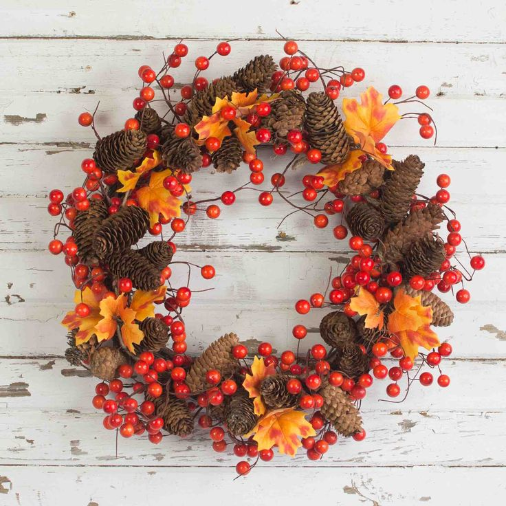 Bella Marie's Fall Orange Berry Wreath is designed with using artificial rich orange berries, natural pine cones, and artificial leaves. This wreath is simple, rustic and unique. Use as a wreath or a