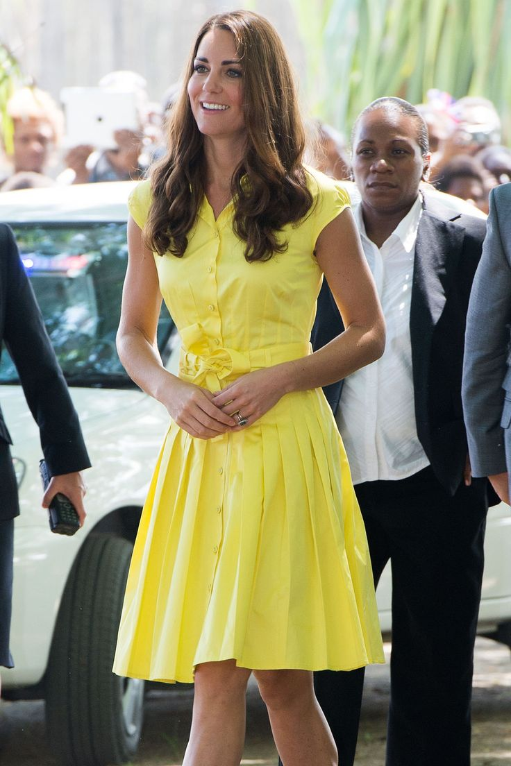 Kate Middleton wore a casual yellow shirt dress—this one is by the brand Jaeger—for a visit to a village in the Solomon Islands.