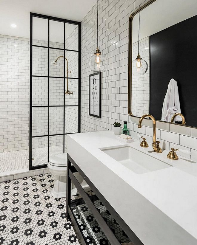 TILE GOALS. (The antique brass fixtures, steel-framed shower door, and quartz counters don't hurt either.)