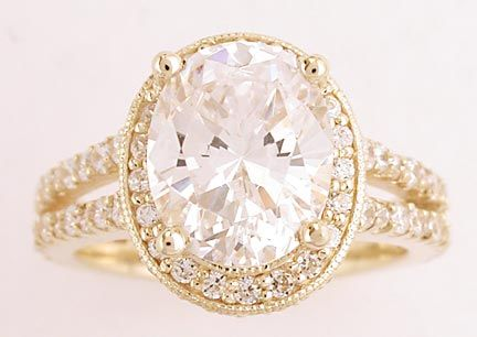 This ring is truly a statement piece.  It features a 2.75 carat oval cz surrounded by over 100 tiny round stones in a halo design with a split band.  The ring is 14k and is available in white and yellow gold, as well as platinum from Orleans Jewels.