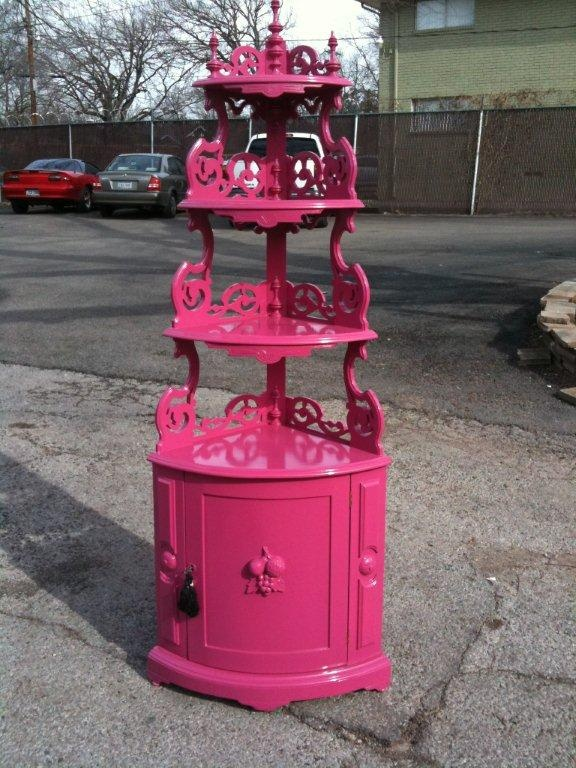 hot pink corner shelf - probably some hideous brown thing before