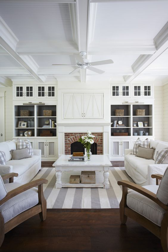 This living room is beautiful. Love the white and grey - all it needs is a roaring stove!