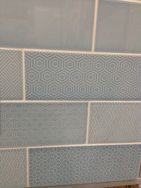 Attingham powder blue with random geometric patterns from Topps Tiles, lovely!  Have a look at our beautiful bathroom too.