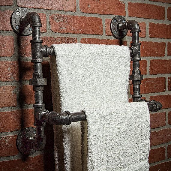 A handmade industrial chic towel rod with rustic shelf that is sure to add a truly charming accent to any home. This unique and re-imagined blend of metal