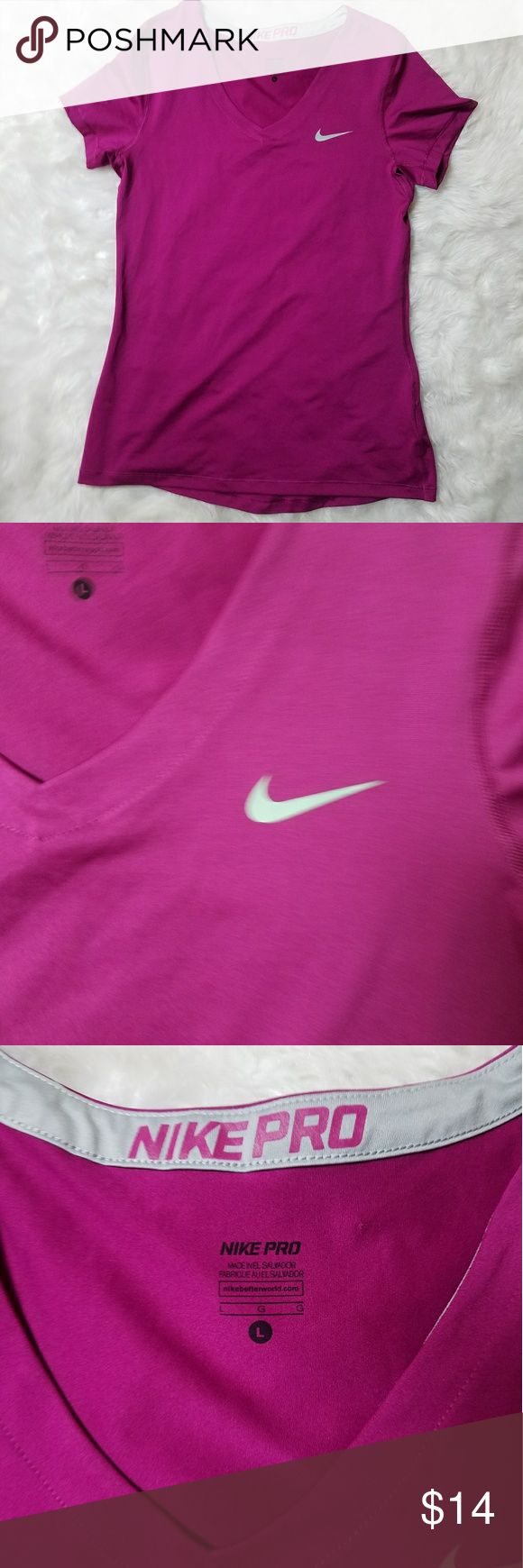 Nike Pro shorts leave v-neck purple shirt large Nike Pro Dri-Fit women's short sleeve v-neck purple shirt size large  (B)  60% cotton 40% polyester  armpit to armpit measures 17in unstretched  armpit to hem measure 17 in  excellent used condition Nike Tops Tees - Short Sleeve