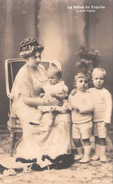 Queen Victoria Eugenie holding Infanta Beatriz of Spain, with Infante Jaime of Spain, and Alfonso, Prince of Asturias