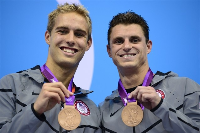 US bronze medalists Kristian Ipsen and Troy Dumais pose on the podium of the men's synchronised 3m springboard diving event