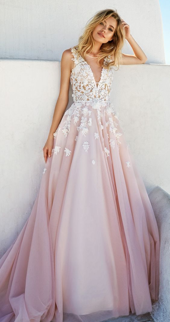 A Pink Wedding Dress Without Sleeve With Covered Plunging Neckline And White Lace Liques On The Bodice Skirt