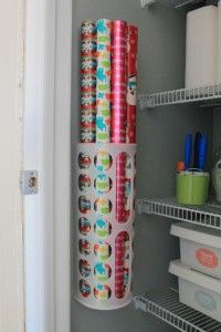 Plastic bag holders are also an excellent way to create wrapping paper storage space in your closet!