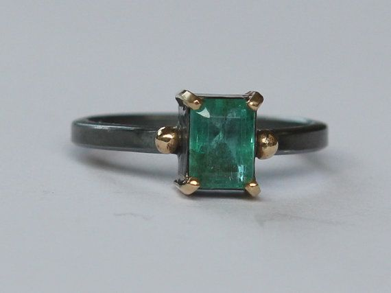 Size 7.5 hammer forged sterling silver ring. The stone is a high quality emerald cut natural .98 ct dark green Zambian emerald (panna stone). The