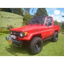 Toyota Land Cruiser Macho, Roja, Totalmente Restaurada.