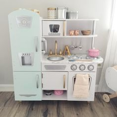 Kid Kraft Kitchen hack. Kid Kraft kitchen makeover. And the details- @kidkraft_lp vintage white kitchen. Painted the fridge mint green. Put marble contact paper on the counter top. Sprayed the faucet gold and some of the handles. (Ordered different handles but got the wrong size ) Accessories from @westelmindianapolis @anthropologie and @thecontainerstore
