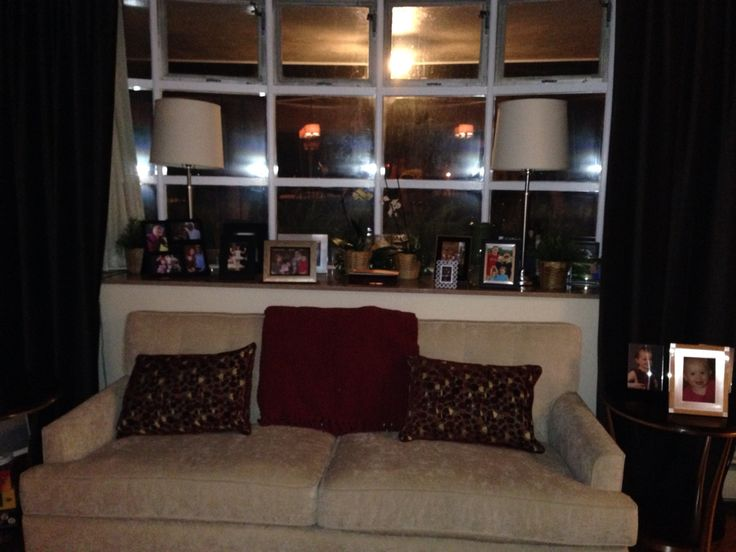 Big window ledge.  Pictures? getting crowded.  maybe move some to picture gallery on wall. move maps behind cough?