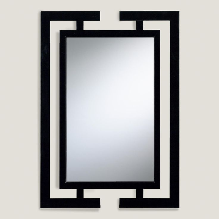Featuring a bold black wood frame inspired by contemporary Asian decor, our beveled silver glass mirror is a striking statement piece.