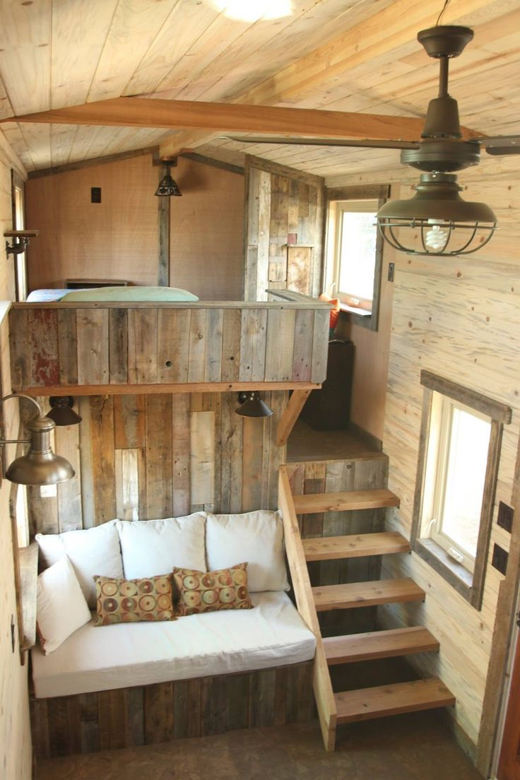 A beautiful custom rustic home from SimBLISSity Tiny Homes. Made from a pine and corrugated metal exterior with a warm, cabin-like interior. - not into the rustic look but like the use of space between bedroom and seating area.