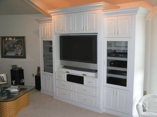closed small cabinets across top of open no glass display shelves on the sides and glass doors. Black Bedroom Furniture Sets. Home Design Ideas