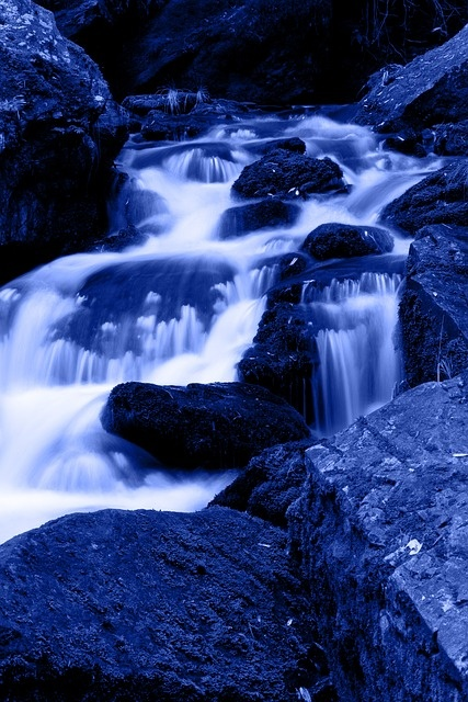 A brilliant blue - cascading water.