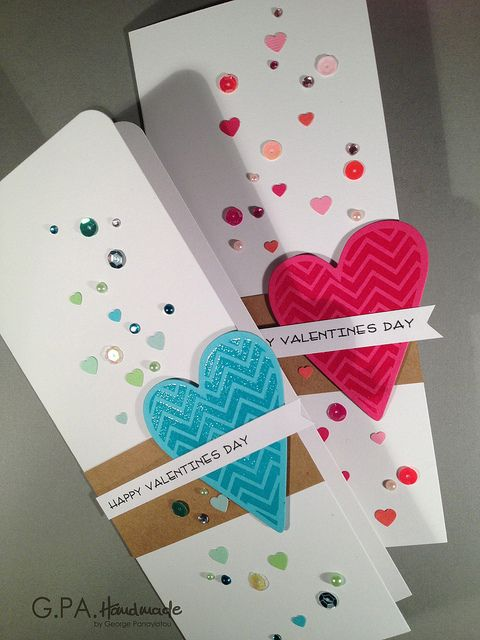 I love the super tall and thin style of this handmade valentine's card - and all the bling!  A fun zig zag heart is the centerpiece, but it's the eye-catching mix of gems, rhinestones, sequins and other confetti that make this an outstanding handmade valentine's card.