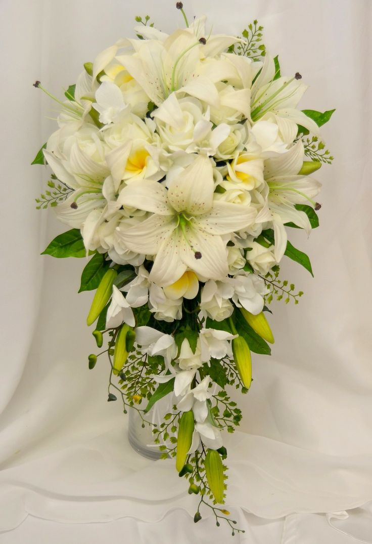 Lily , frangipani, orchids and rose cascading teardrop bouquet