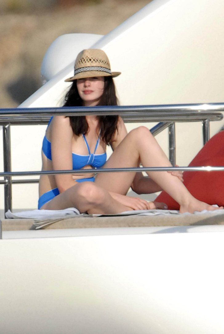 Pin for Later: Set Sail With Over 50 Celebrity Boating Pictures!  Anne Hathaway chilled in a blue bikini and straw hat during a trip to Portocervo, Italy in 2007.