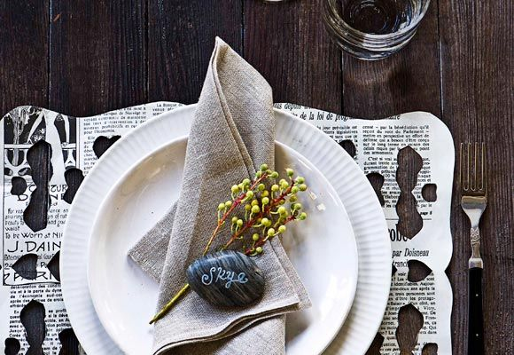 Woodland wonder   Neutral-coloured crockery, napery and placemat. Black-handled cutlery. Decorative sprig and polished stone placecard… This place setting has a lunch-in-the-forest vibe, with the placemat cutouts reminiscent of a bird-pecked treetrunk.