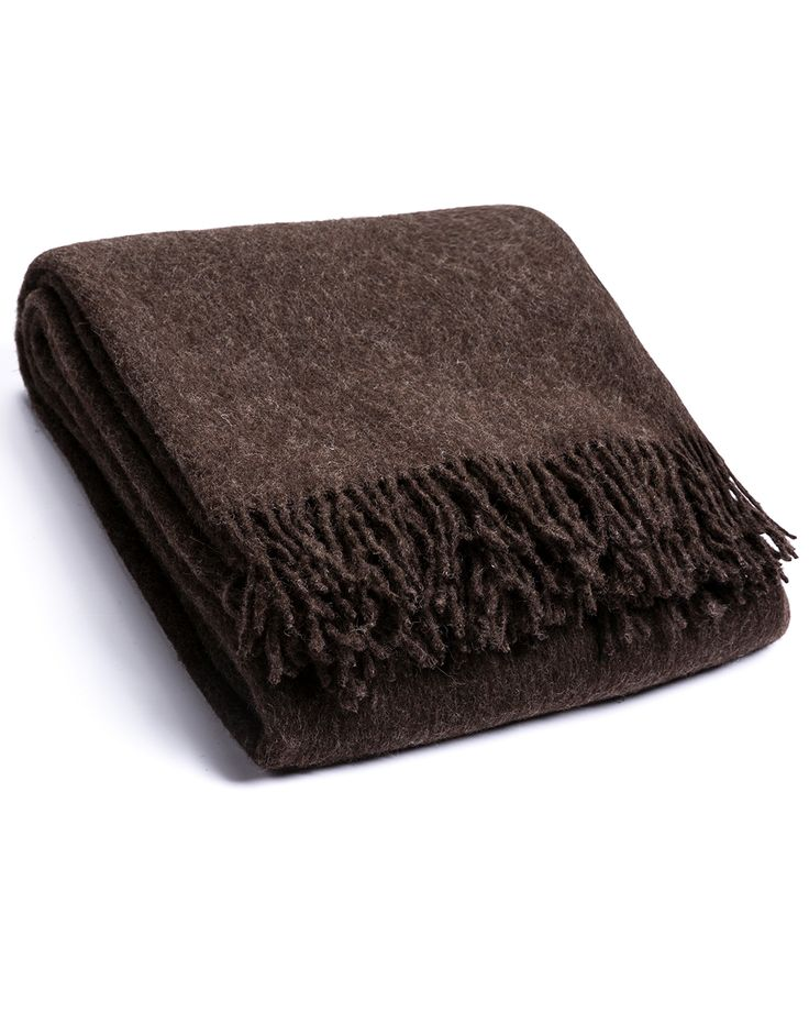 Shubert Wool Blanket. Made from top quality soft wool, warm and cosy blanket is ideal for placing over bed or sofa linen.