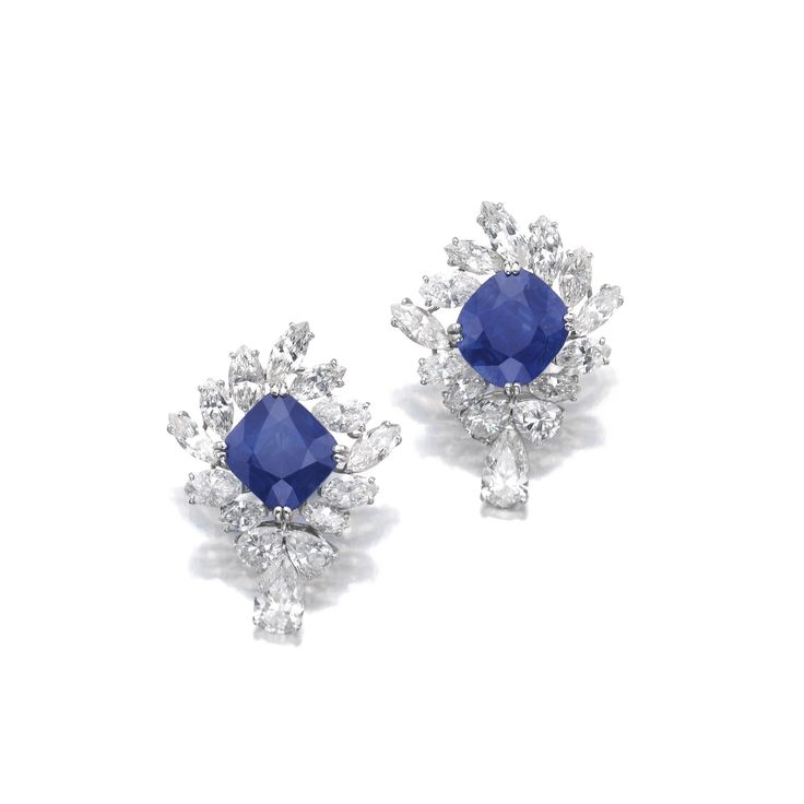 VERY IMPORTANT PAIR OF SAPPHIRE AND DIAMOND EAR CLIPS, CUSI. Each centring on a cushion-shaped sapphire weighing 12.29 carats and 13.09 carats respectively, framed by marquise-shaped diamonds, suspending three pear-shaped stones, Italian assay marks.