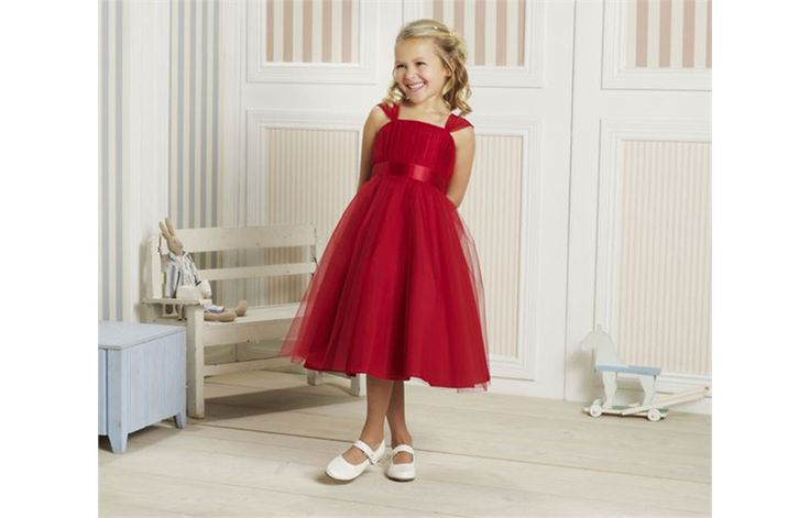 Flower girl outfits don't always have to be shades of pink, white or ivory. We fell head over heels in love with this stunning red dress that is perfect for a slightly older flower girl. She can stun everyone with her gorgeous wedding day look and accompany you down the aisle in a vibrant dress that is full of fun vibes.