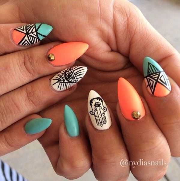 Be bold and creative with this tribal inspired stiletto nails. Coated with blue and orange color combinations, you will simply love the lines and stripes that play along your nails. A very creative looking nail art design you will fall in love with.