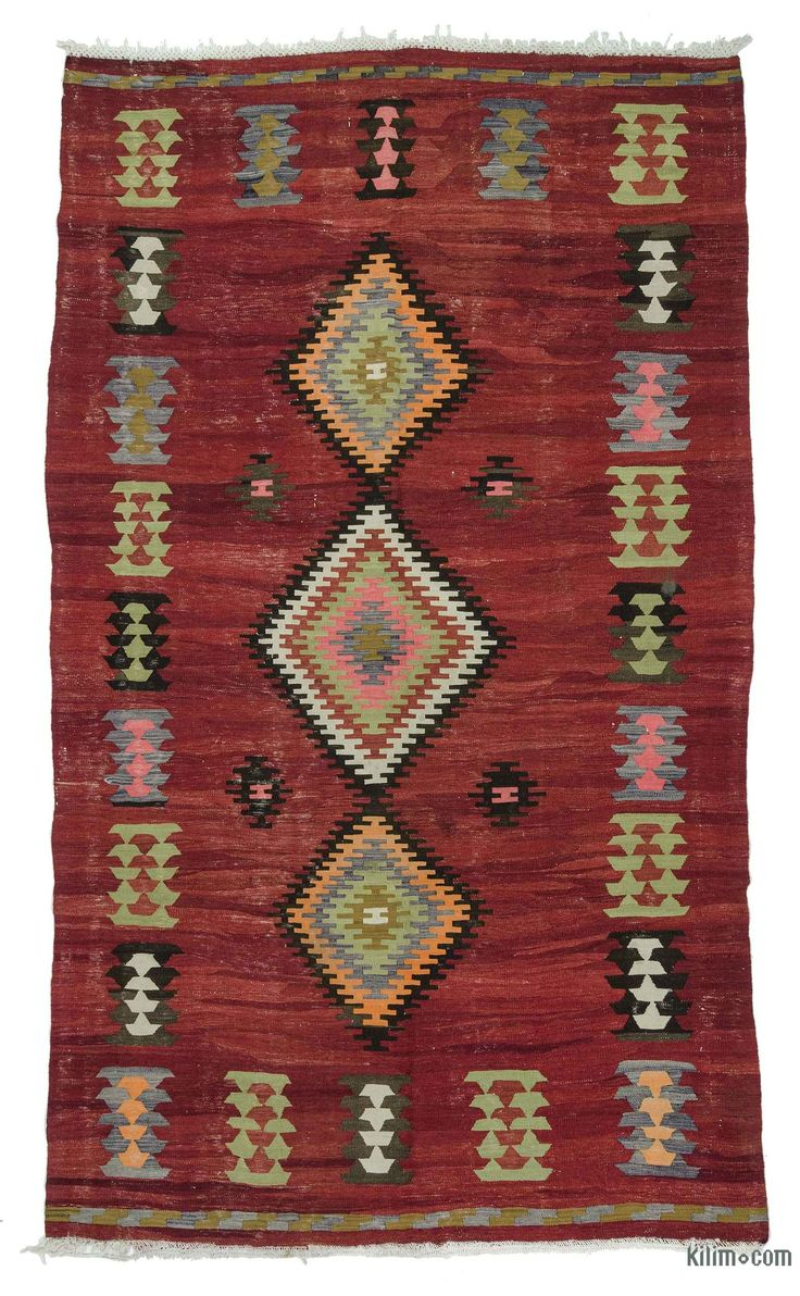 Vintage Turkish kilim rug handwoven in Eskisehir, in Central Anatolia in 1960's. This red rug with tribal designs is in very good condition.