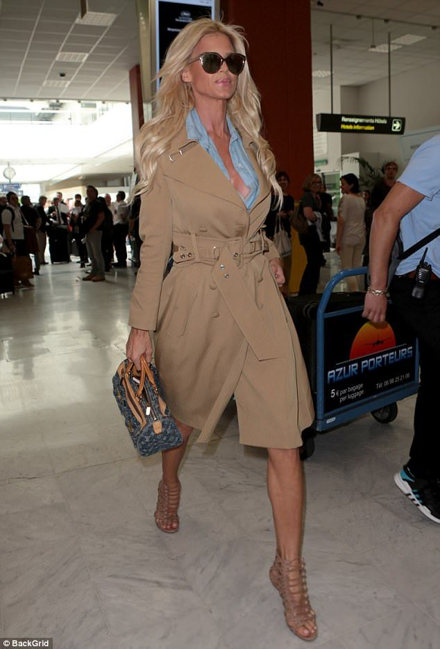 Jet-setter: Victoria Silvstedt looked stylish in a classic trench coat as she touched down in Nice for the Cannes Film Festival on Tuesday