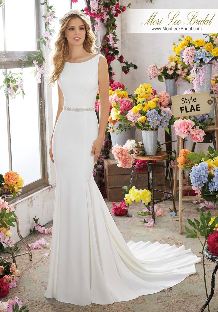 Style FLAE Melissa Wedding Dress  Modern and Sophisticated, This Crepe Sheath Wedding Dress Features Gorgeous Crystal Beaded Back Straps and a Removable Crystal Beaded Net Belt. Colors Available: White/Silver, Ivory/Silver. Shown in Ivory/Silver.