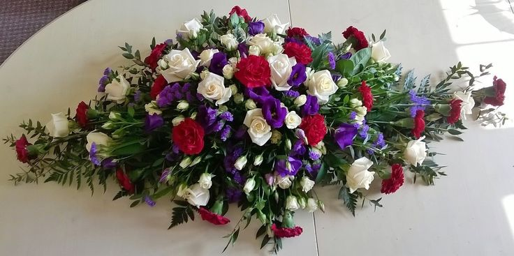 red, white and blue coffin funeral spray