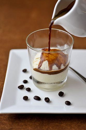 Affogato - Icecream and coffee dessert    1 Scoops of ice cream  3 Tablespoons strongly brewed coffee   1 teaspoon Frangelico (hazelnut) liqueur    Put ice cream scoops in a small glass or cup.   Pour hot coffee over the ice cream.  Add shot of liqueur.    Simply Delissimo.