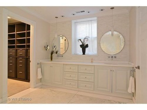 Web Image Gallery Love the wall of tile and the round Venetian mirrors Also the wall mounted