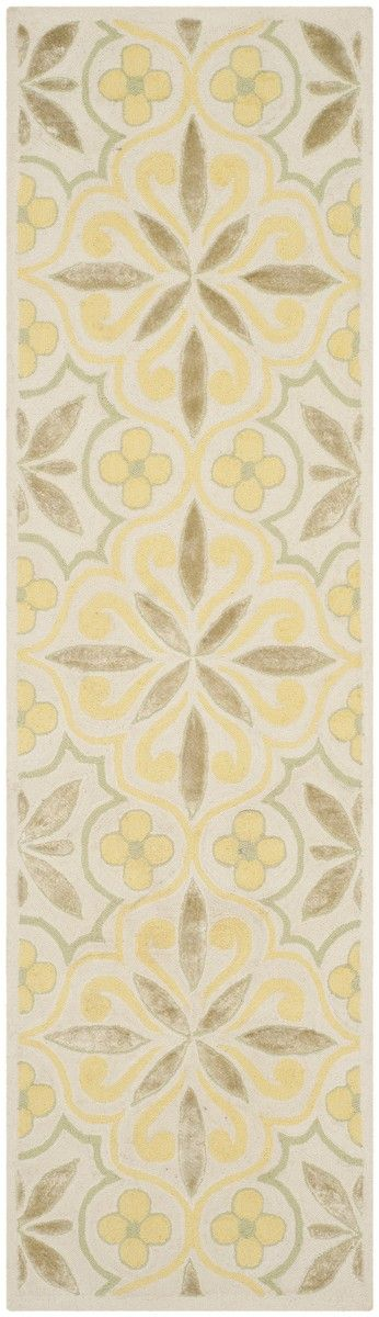 IMR359A Rug from Isaac Mizrahi collection.  Brighten any room with the country casual Sunshine Quilt rug from Isaac Mizrahi New York Collection Rugs.  Hand-hooked of wool and viscose in yellow and be