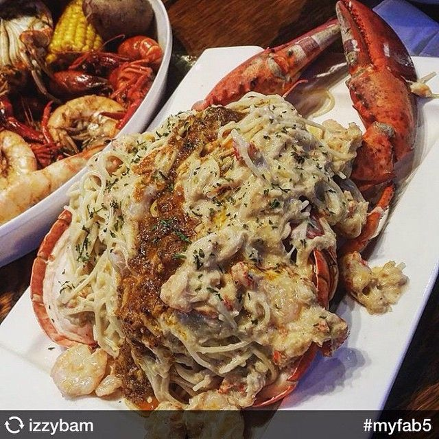 Lobster Pasta from Sweetwater Seafood is anything but boring.  The lobster is split open and stuffed with shrimp, crawfish, crab meat, and pasta with Alfredo sauce.