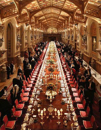 St. George's Hall at Windsor Castle, Berkshire, England. The hall is 55.5 metres long and 9 metres wide, with a table seating for up to 160 guests.
