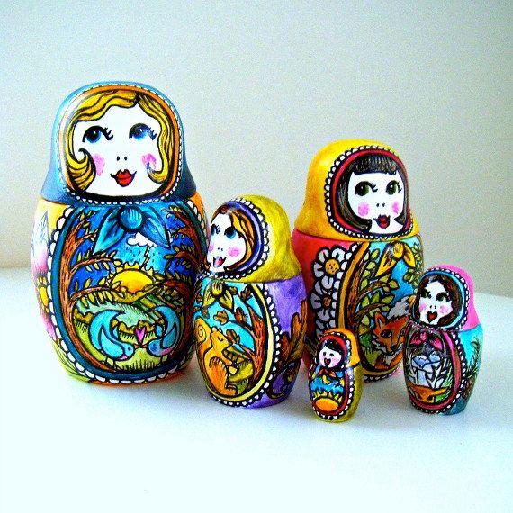 I have loved nesting dolls since I was a kid! Russian Nesting Dolls Four Seasons Folk Art Hand Painted Ceramic Matryoshka Babushka Red Blue Yellow Forest Woodland -  Made to Order on Etsy, $155.00