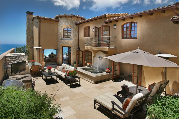 Located on Barranca Way in Laguna Beach, California, this Mediterranean-inspired luxury home enjoys breathtaking views of Catalina Island and the Pacific Ocean.  There is a beautiful stone entry courtyard with outdoor fireplace and a private spa fountain.
