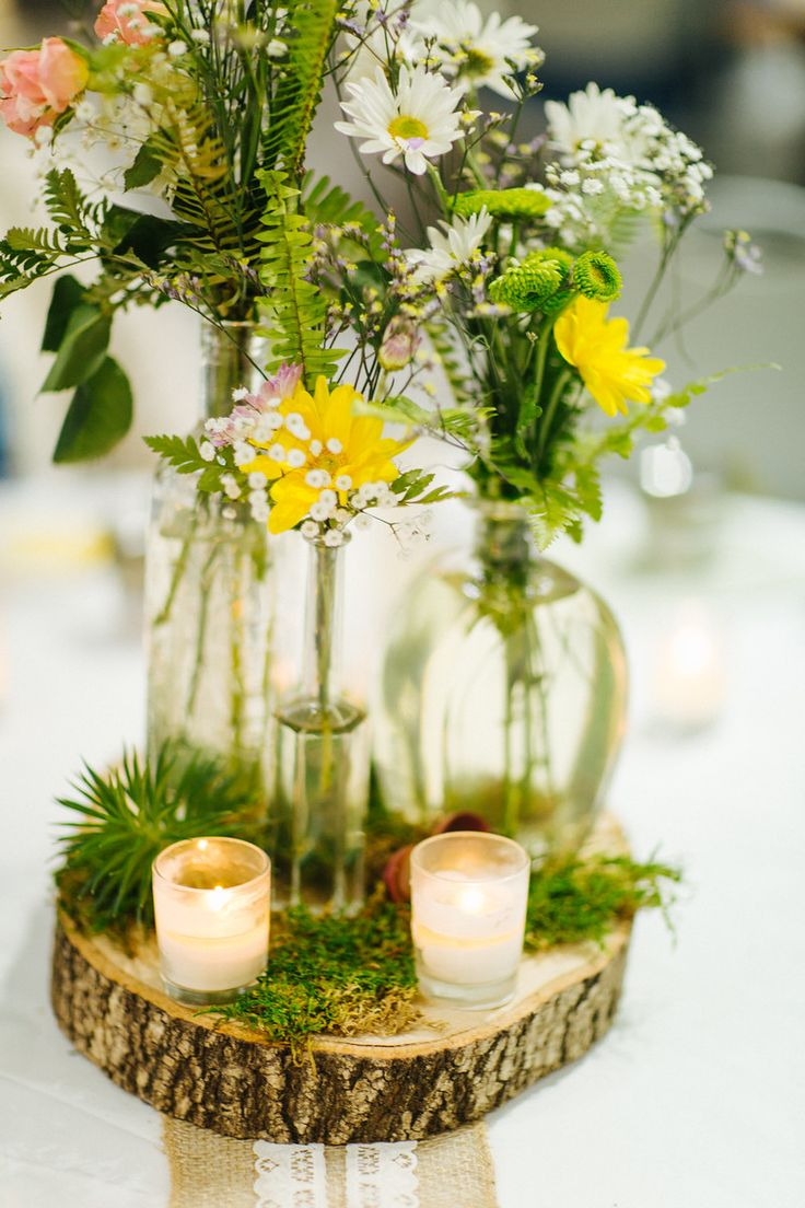 Wildflower nature wedding centerpieces with wood slices