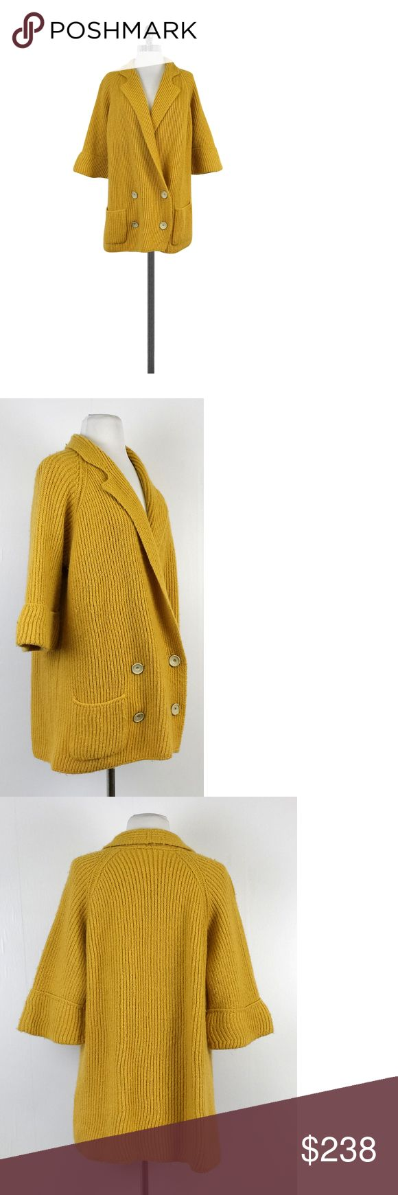 "Chloe- Mustard Yellow Oversized Knitted Cardigan Sz S Oversized cardigan to keep you warm and warm mustard yellow color to keep you happy in the winter. Pair with black knee high boots & skinny jeans for a trendy look. Size S 70% alpaca 30% wool Made in Italy Linted Short sleeves w/foldover cuffs Double front buttons 2 front open hip pockets Priced as is Shoulder to hem 29"" Chloe is a French fashion house that has been in the business for decades. Chloe prides itself in luxury ready-to-wear…"